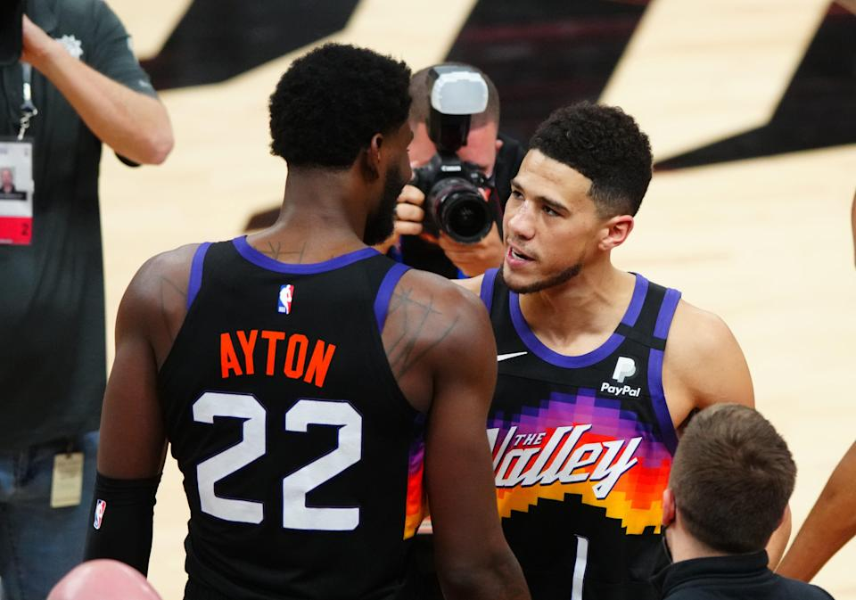 The Suns young duo of Dandre Ayton (22) and Devin Booker vowed to learn from the experience of falling short in their first NBA Finals.