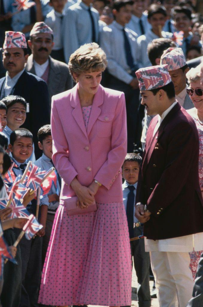 <p>In March 1993, Diana sported this pretty pink blazer over a polka dot dress during a visit to a school in Nepal.<br></p>