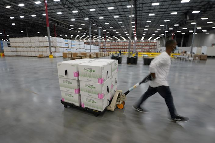 Boxes containing the Moderna COVID-19 vaccine are prepared to be shipped at a distribution center in Olive Branch, Miss., on Dec. 20. (Paul Sancya/Pool via Reuters)