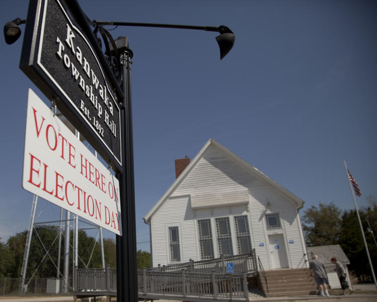 Primary election voters arrive at the Kanwaka Township Hall near Lawrence, Kan., Tuesday, Aug. 7, 2012. Republican primary voters in Kansas could reshape the Legislature on Tuesday, with conservatives hoping to oust moderate GOP incumbents in the Senate who have stymied the right's political agenda. (AP Photo/Orlin Wagner)
