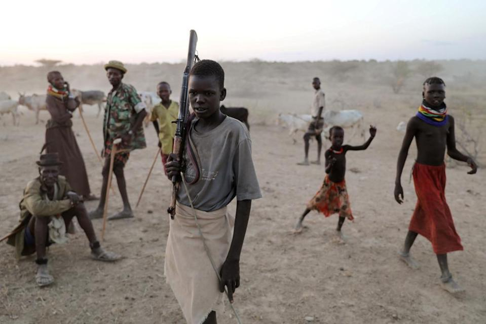 A young Turkana warrior arrives with cattle to a settlement in Ilemi Triangle, Kenya.