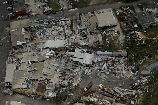 Aluminum roofing is seen twisted and thrown off buildings as recovery efforts continue following Hurricane Maria near San Jose, Puerto Rico, on Oct. 7.