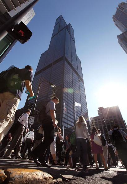 Commuters walk past the former Sears Tower July 16, 2009 in Chicago, Illinois. The building was renamed the Willis Tower today, after London-based insurance broker Willis Group Holdings, a major tenant in the building. The building, once the tallest in the world, was opened in 1973 to house the offices of the then largest retailer in the world Sears, Roebuck & Co. (Photo by Scott Olson/Getty Images)