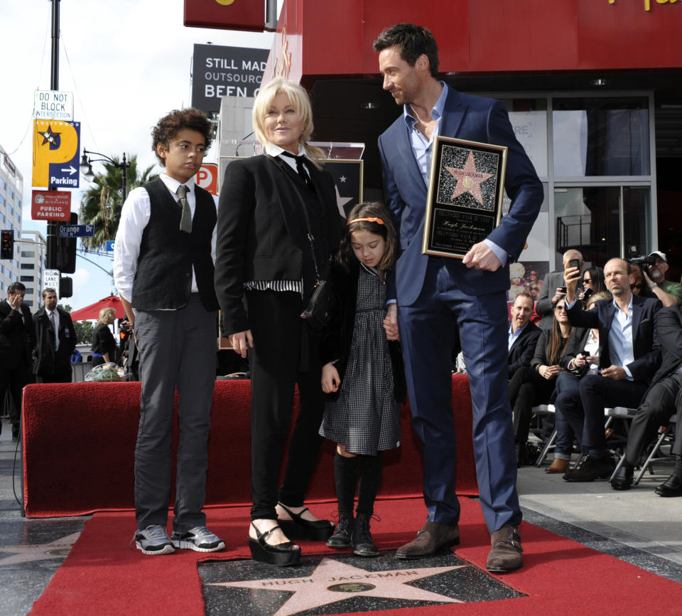 From left to right, Oscar Jackman, actress Deborra-Lee Furness, Ava Jackman, and actor Hugh Jackman pose together at Hugh Jackman's star ceremony at the Hollywood Walk of Fame on Thursday, Dec. 13, 2012, in Los Angeles. (Photo by Dan Steinberg/Invision/AP)