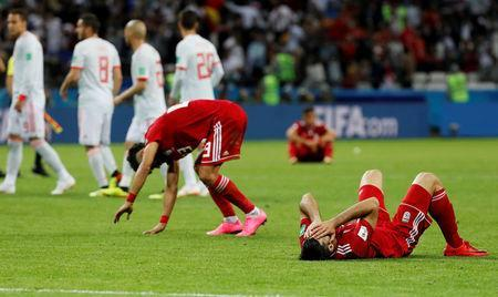 Soccer Football - World Cup - Group B - Iran vs Spain - Kazan Arena, Kazan, Russia - June 20, 2018 Iran players look dejected after the match REUTERS/Toru Hanai