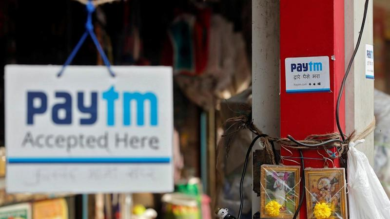 Advertisements of Paytm, a digital wallet company, are seen placed at stalls. Reuters