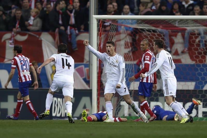Real's Cristiano Ronaldo, centre, celebrates his goal during a Spanish La Liga soccer match between Atletico de Madrid and Real Madrid at the Vicente Calderon stadium in Madrid, Spain, Sunday, March 2, 2014. (AP Photo/Andres Kudacki)