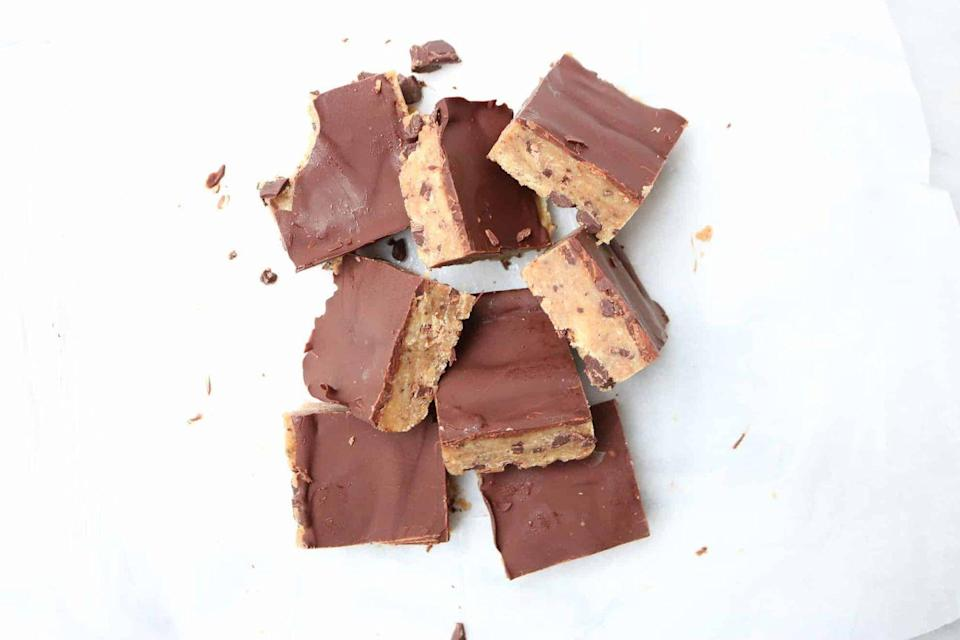 """<p>If chocolate fudge and cookie dough had a baby, it'd be these bars.</p><p><a class=""""link rapid-noclick-resp"""" href=""""https://thetoastedpinenut.com/no-bake-cookie-dough-bars/"""" rel=""""nofollow noopener"""" target=""""_blank"""" data-ylk=""""slk:GET THE RECIPE"""">GET THE RECIPE</a></p><p><em>Per serving: 202 calories, 14.4 g fat (4.4 g saturated), 16.5 g carbs, 18 mg sodium, 3.8 g fiber, 4.8 g protein</em></p>"""