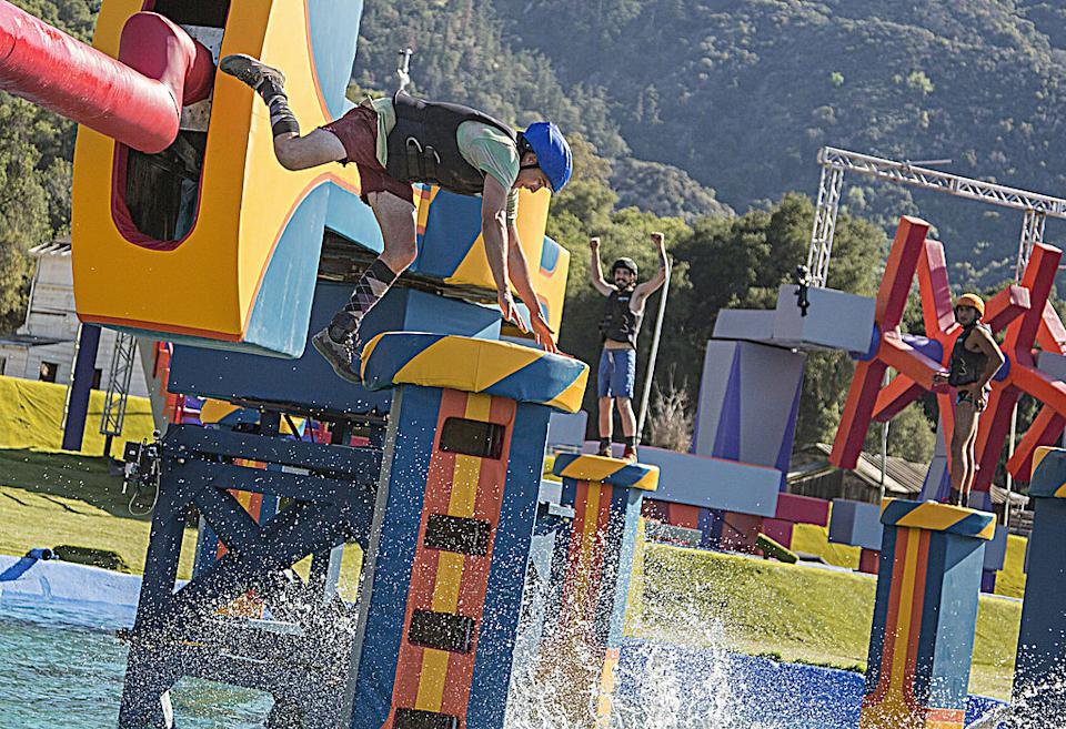 Contestants on an episode of Wipeout on 2014.