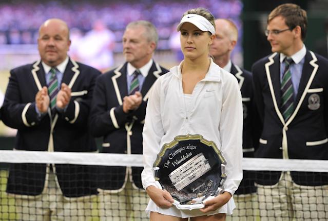 Runner up Canada's Eugenie Bouchard holds her trophy after losing to Czech Republic's Petra Kvitova in the women's singles final match on day 12 of the 2014 Wimbledon Championships in Wimbledon on July 5, 2014 (AFP Photo/Glyn Kirk)