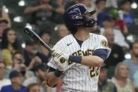 Milwaukee Brewers' Christian Yelich hits a three-run scoring double during the fourth inning of a baseball game against the Pittsburgh Pirates Saturday, June 12, 2021, in Milwaukee. (AP Photo/Morry Gash)