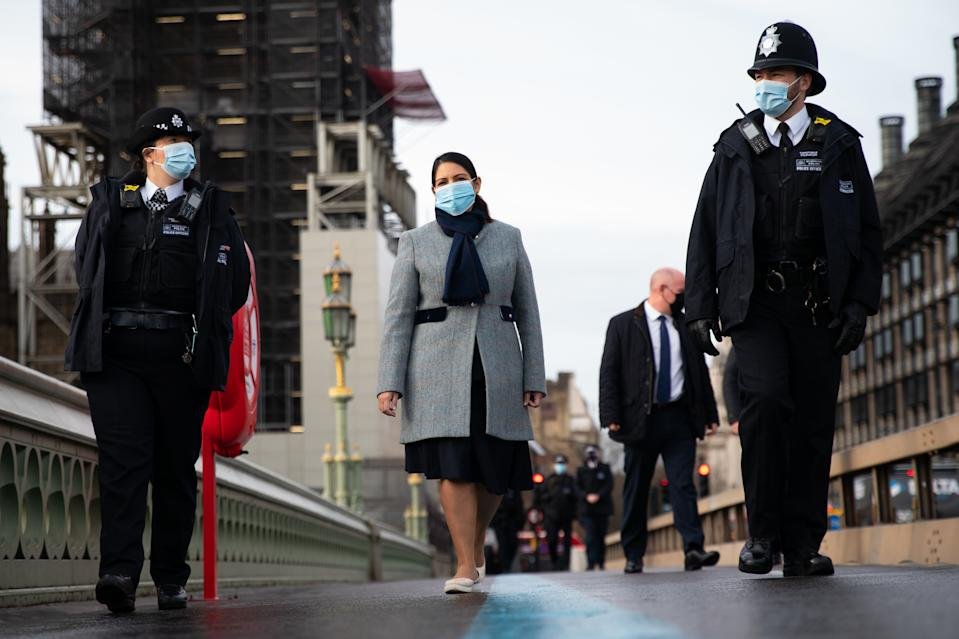 Home Secretary Priti Patel walks across Westminster Bridge whilst on patrol with Metropolitan Police officers in central London, to hear about about Covid enforcement. Picture date: Monday January 18, 2021.