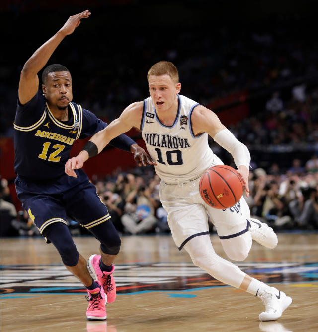 Villanova's Donte DiVincenzo (10) drives past Michigan's Muhammad-Ali Abdur-Rahkman (12) during the first half in the championship game of the Final Four NCAA college basketball tournament, Monday, April 2, 2018, in San Antonio. (AP Photo/Eric Gay)