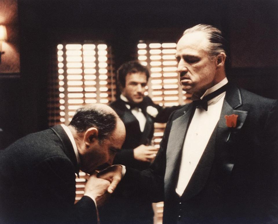 """<a href=""""http://movies.yahoo.com/movie/the-godfather/"""" data-ylk=""""slk:THE GODFATHER"""" class=""""link rapid-noclick-resp"""">THE GODFATHER</a> (1972) <br>Directed by: <span>Francis Ford Coppola</span> <br>Starring: <span>Marlon Brando</span>, <span>Al Pacino</span> and <span>James Caan</span>"""