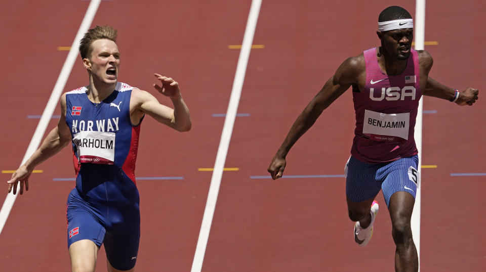 Karsten Warholm, of Norway celebrates as he wins the gold medal ahead of Rai Benjamin, of United States in the final of the men's 400-meter hurdles at the 2020 Summer Olympics, Tuesday, Aug. 3, 2021, in Tokyo, Japan. (AP Photo/Charlie Riedel)