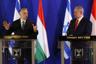 Hungarian Prime Minister Viktor Orban, left, and Israeli Prime Minister Benjamin Netanyahu attend a press conference after their meeting in Jerusalem, Tuesday, Feb. 19, 2019. (AP Photo/Ariel Schalit, Pool)