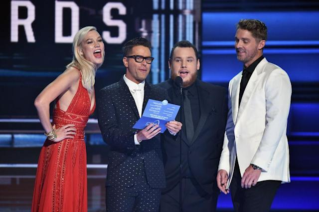 <p>Karlie Kloss, Bobby Bones, Luke Combs, and Brett Young speak onstage at the 51st annual CMA Awards at the Bridgestone Arena on November 8, 2017 in Nashville, Tennessee. (Photo by John Shearer/WireImage) </p>