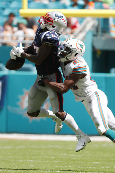 New England Patriots wide receiver Antonio Brown (17) cannot hold onto a pass as Miami Dolphins cornerback Eric Rowe (21) defends, during the second half at an NFL football game, Sunday, Sept. 15, 2019, in Miami Gardens, Fla. (AP Photo/Wilfredo Lee)