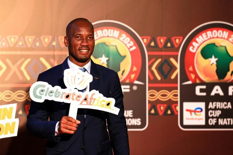 """Former Ivory Coast star Didier Drogba holds a """"celebrate Africa"""" sign during the Africa Cup of Nations draw ceremony in Yaounde, Cameroon, on Tuesday"""