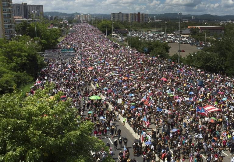 Protesters fill the Expreso Las Americas highway in Puerto Rico, calling for the resignation of Governor Ricardo Rossello (AFP Photo/JOE RAEDLE)