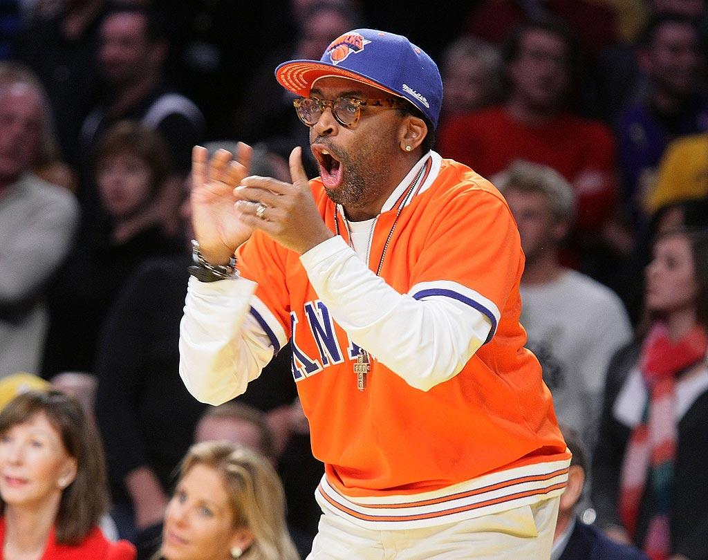 """New York native Spike Lee gets his clap on while encouraging his beloved Knicks. Noel Vasquez/<a href=""""http://www.gettyimages.com/"""" target=""""new"""">GettyImages.com</a> - December 16, 2008"""