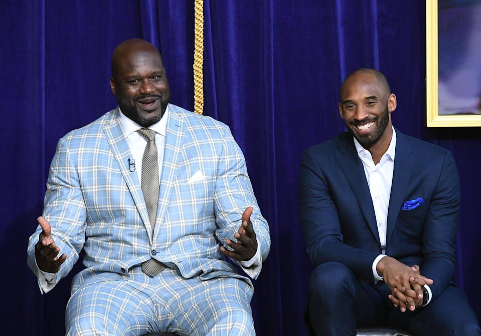 Shaquille O'Neal reacts to his former players seated in the audience with Kobe Bryant looking on during unveiling of his statue at Staples Center March 24, 2017, in Los Angeles. (Photo by Kevork Djansezian/Getty Images)