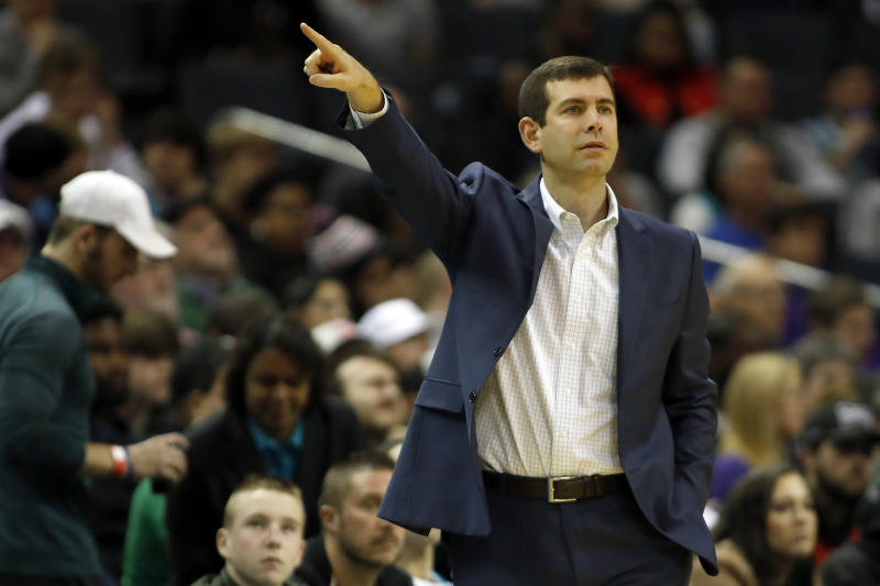 Boston Celtics' head coach Brad Stevens points the way from the sidelines against the Charlotte Hornets during the first half of an NBA basketball game in Charlotte, N.C., Tuesday, Dec. 31, 2019. (AP Photo/Bob Leverone)