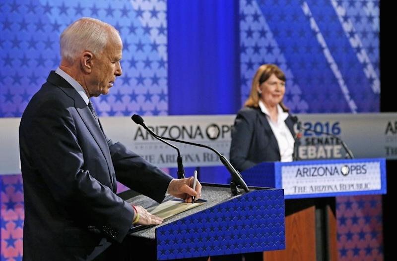 Incumbent Republican Sen. John McCain, left, takes a few notes as Arizona Democratic Rep. Ann Kirkpatrick speaks to the debate moderators prior to their only scheduled debate Monday, Oct. 10, 2016, in Phoenix before next month's general election. (Photo: Ross D. Franklin/AP)