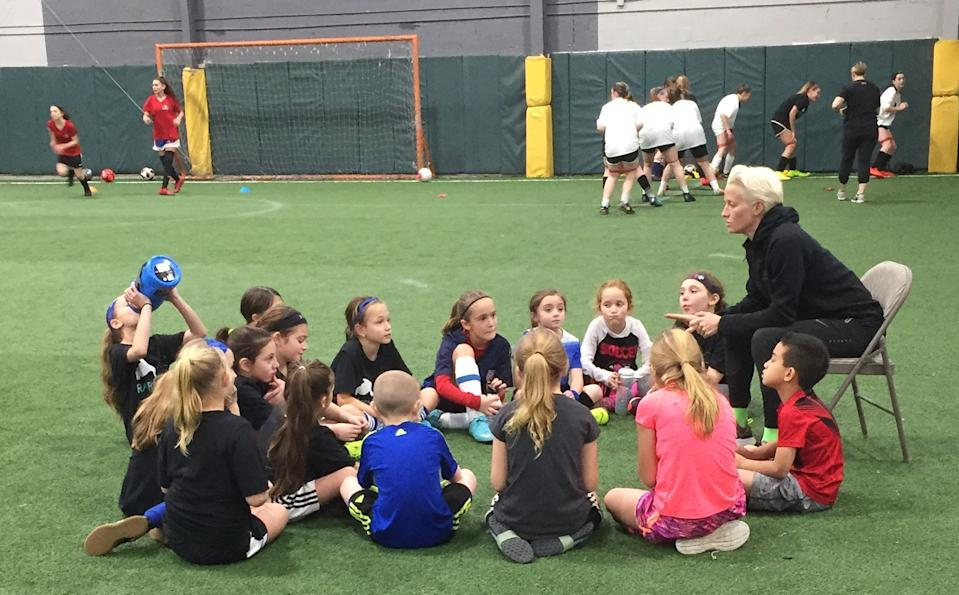 Megan Rapinoe speaks to campers at the Rapinoe SC training clinic on Long Island. (Yahoo Sports)