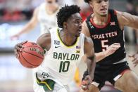 Baylor's Adam Flager (10) controls the ball during the second half of an NCAA college basketball game against Texas Tech in Lubbock, Texas, Saturday, Jan. 16, 2021. (AP Photo/Justin Rex)