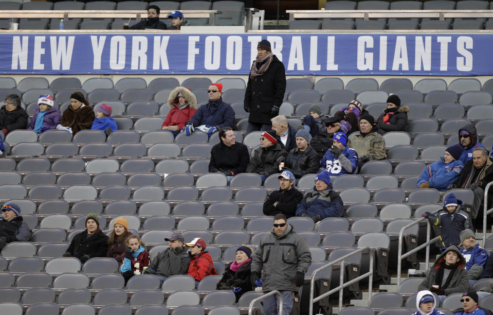 There are plenty of questions of whether or not fans will be able to attend NFL games this season, and what types of social distancing they may encounter. (AP Photo/Kathy Willens)