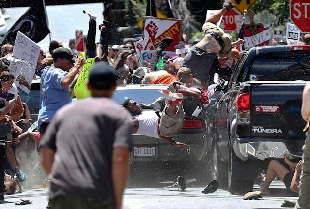 <p>AUG. 12, 2017 – People fly into the air as a vehicle drives into a group of protesters demonstrating against a white nationalist rally in Charlottesville, Va. 32-year-old Heather Heyer, a Charlottesville resident and legal assistant was killed.<br> Heyer was among the hundreds of protesters who had gathered Saturday in Charlottesville to decry what was believed to be the largest gathering of white supremacists in a decade – including neo-Nazis, skinheads and Ku Klux Klan members. They descended on the city for a rally prompted by the city's decision to remove a Confederate monument. (PHOTO: Ryan M. Kelly/The Daily Progress via AP) </p>