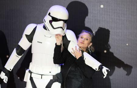 retireFILE PHOTO - Carrie Fisher  poses for cameras as she arrives at the European Premiere of Star Wars, The Force Awakens in Leicester Square, London