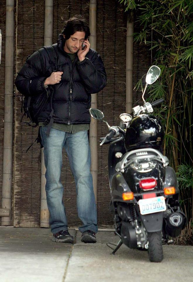 "Oscar winner Adrien Brody chats on his cell before riding his Yamaha down Melrose Avenue in Los Angeles. Katie Lee Arrowsmith/<a href=""http://www.splashnewsonline.com"" target=""new"">Splash News</a> - January 19, 2006"