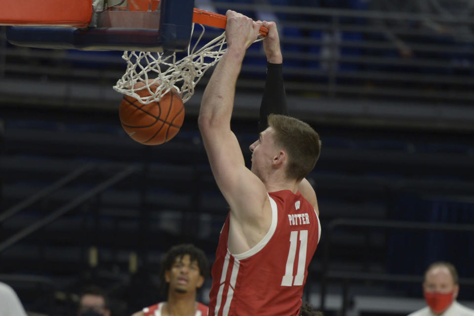 Wisconsin's Micah Potter (11) goes up for a dunk against Penn State during the second half of an NCAA college basketball game, Saturday, Jan. 30, 2021, in State College, Pa. (AP Photo/Gary M. Baranec)