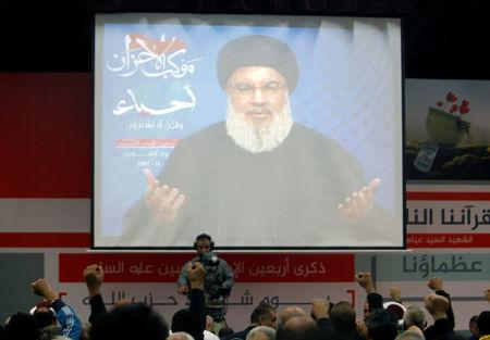 Lebanon's Hezbollah leader Sayyed Hassan Nasrallah is seen on a video screen as he addresses his supporters in Beirut