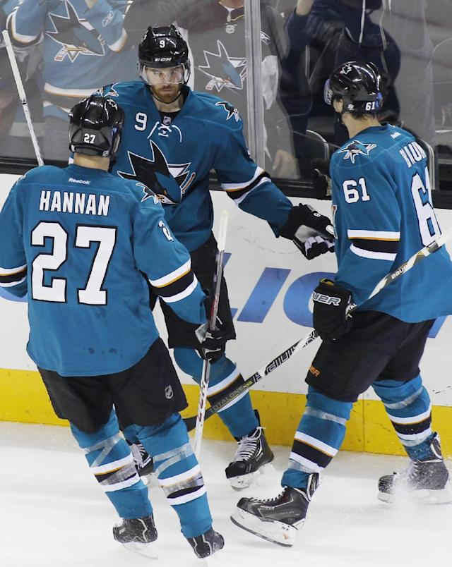 San Jose Sharks' Marty Havlat, center, celebrates with teammates Scott Hannan (27) and Justin Braun after scoring against the Anaheim Ducks during the second period of an NHL hockey game, Saturday, Nov. 30, 2013, in San Jose, Calif. (AP Photo/George Nikitin)