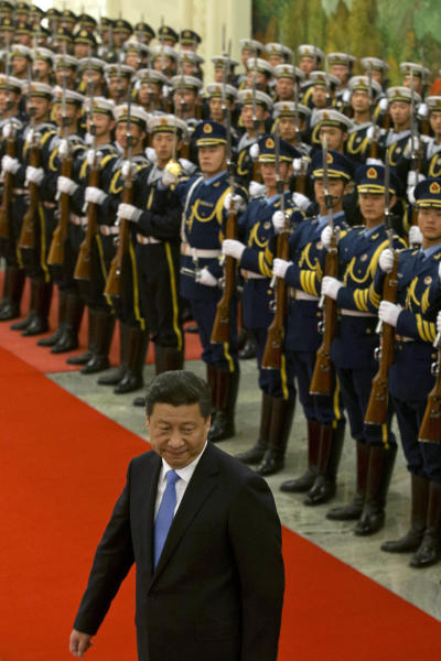 Chinese President Xi Jinping attends a welcome ceremony at the Great Hall of the People in Beijing Wednesday, Nov. 13, 2013. China's plan to create a new security committee demonstrates Xi's success in cementing his authority as Communist Party leader, analysts said Wednesday. Chinese academics for decades have advocated a body to oversee coordination among police, intelligence, military and other security organs, which have sometimes appeared out of step with each other or with the party's civilian leadership despite their emphasis on discipline and unity. (AP Photo/Ng Han Guan)