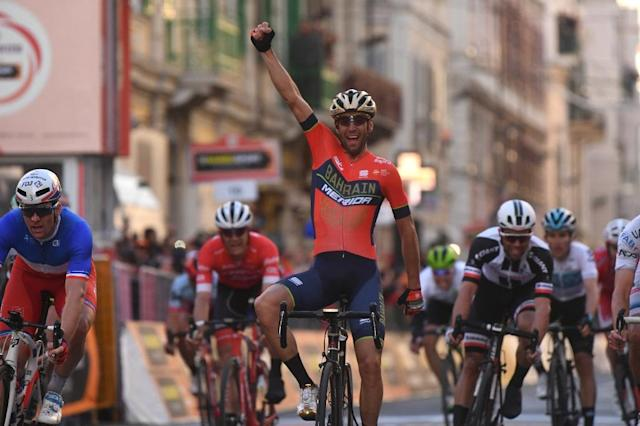Italy's Vincenzo Nibali (C) celebrates after winning the 109th edition of the Milan - San Remo cycling classic in March 2018. (AFP Photo/Marco BERTORELLO)