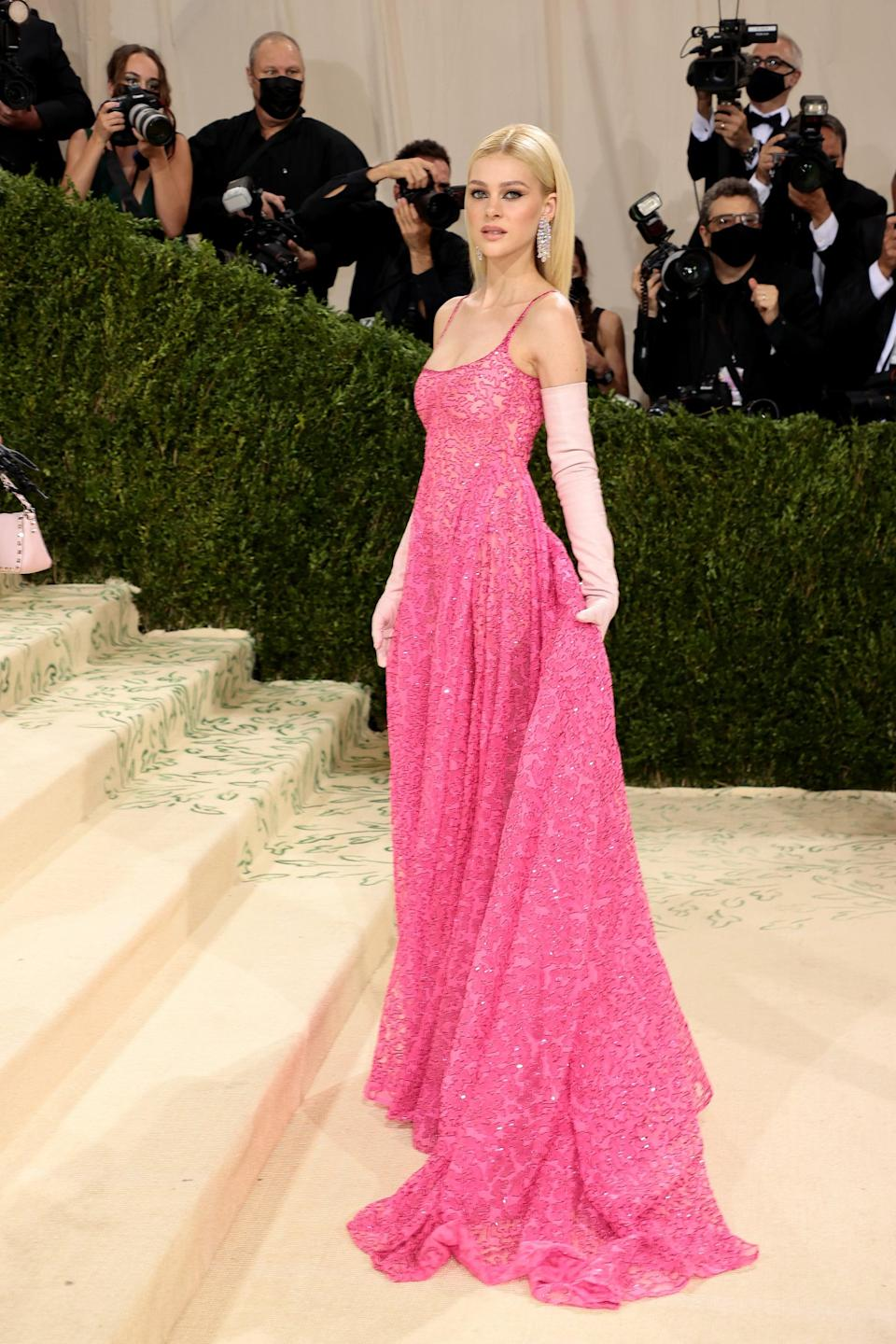 <p>Wearing a Valentino Couture dress.</p>