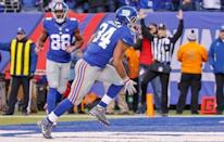 Dec 20, 2015; East Rutherford, NJ, USA; New York Giants running back Shane Vereen (34) scores touchdown during the fourth quarter against the Carolina Panthers at MetLife Stadium. Mandatory Credit: Jim O'Connor-USA TODAY Sports
