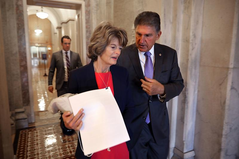 Sens. Lisa Murkowski and Joe Manchin are both seen as swing votes on the Kavanaugh nomination. But only Manchin,a red-state Democrat, is a major target of ad spending. (Chip Somodevilla via Getty Images)