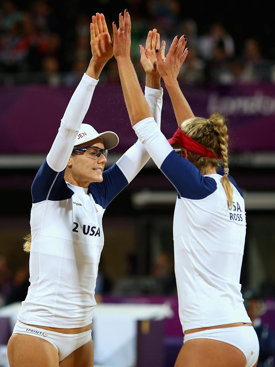 LONDON, ENGLAND - AUGUST 05: April Ross of the United States and Jennifer Kessy of the United States celebrate during the Women's Beach Volleyball Quarter Final match between United States and Czech Republic on Day 9 of the London 2012 Olympic Games at Horse Guards Parade on August 5, 2012 in London, England. (Photo by Ryan Pierse/Getty Images)