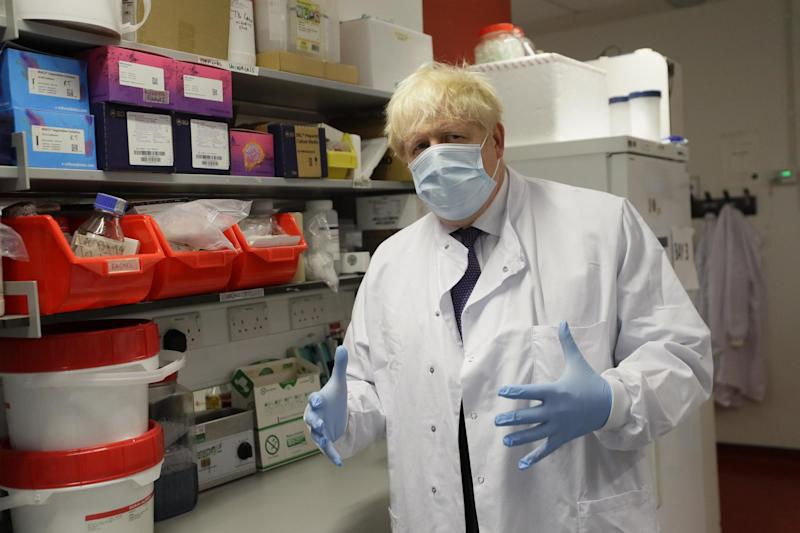 Boris Johnson gestures during a visit to the Jenner Institute in Oxford: PA