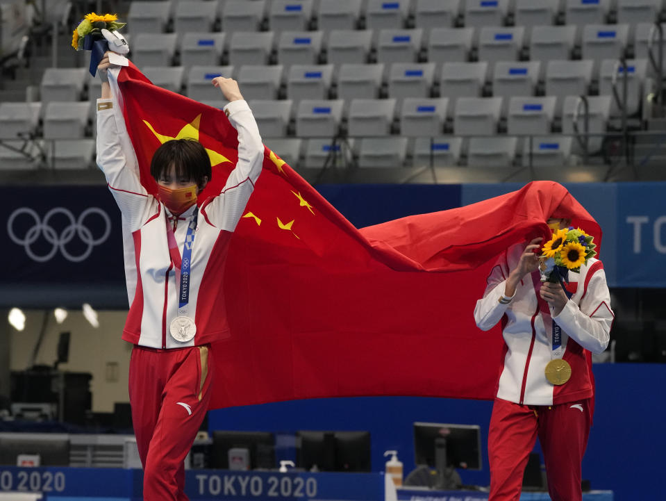 Chen Yuxi of China, left, silver medal and Quan Hongchan of China, gold medal react after winning gold medal in women's diving 10m platform final at the Tokyo Aquatics Centre at the 2020 Summer Olympics, Thursday, Aug. 5, 2021, in Tokyo, Japan. (AP Photo/Dmitri Lovetsky)