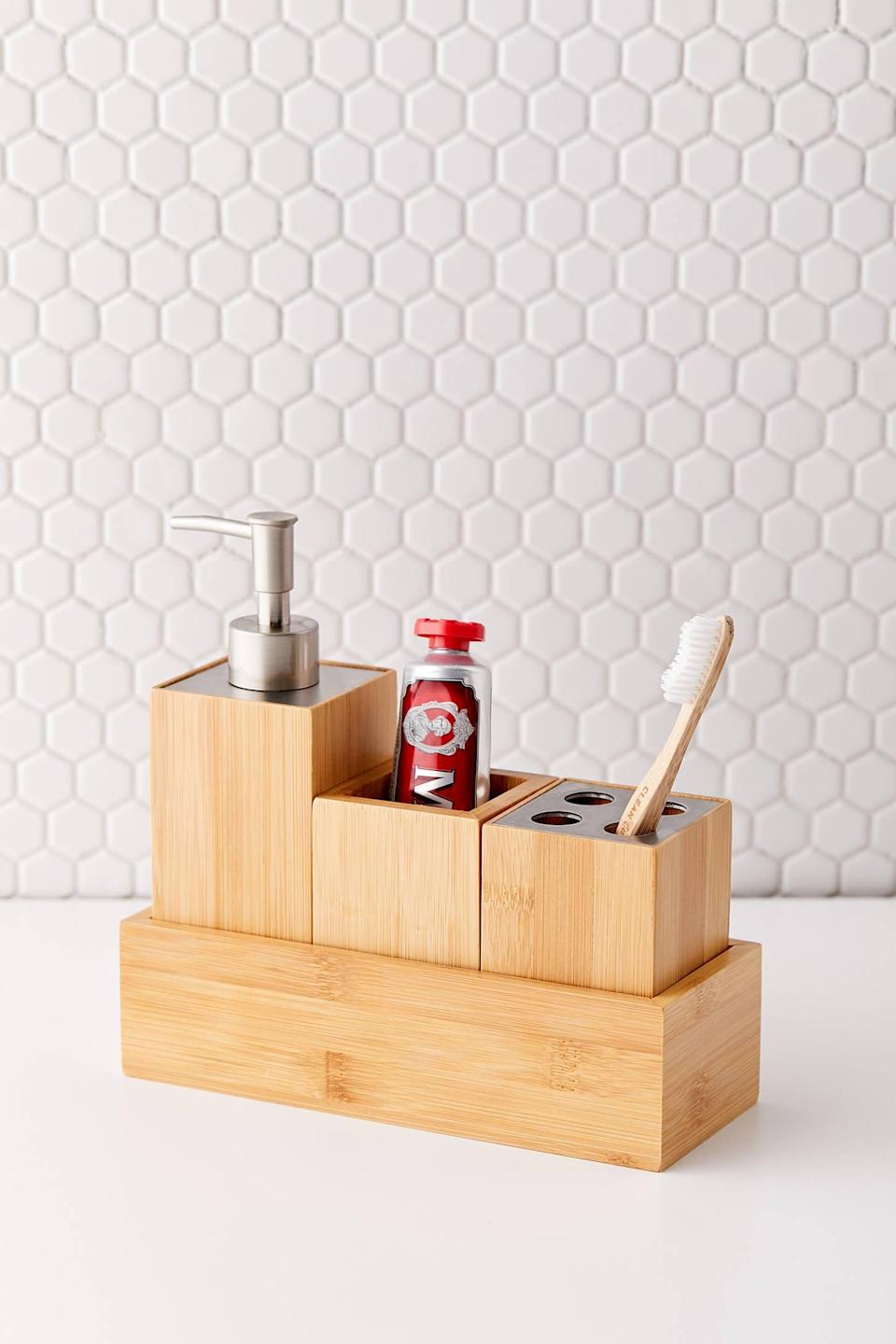 "<p>You bathroom will look neat and tidy with this <a href=""https://www.popsugar.com/buy/Bamboo-Bathroom-Organizer-Set-547058?p_name=Bamboo%20Bathroom%20Organizer%20Set&retailer=urbanoutfitters.com&pid=547058&price=49&evar1=casa%3Aus&evar9=47251564&evar98=https%3A%2F%2Fwww.popsugar.com%2Fhome%2Fphoto-gallery%2F47251564%2Fimage%2F47251610%2FBamboo-Bathroom-Organizer-Set&list1=cleaning%2Corganization%2Cspring%20cleaning%2Csmall%20space%20living%2Cbathrooms%2Chome%20organization&prop13=mobile&pdata=1"" class=""link rapid-noclick-resp"" rel=""nofollow noopener"" target=""_blank"" data-ylk=""slk:Bamboo Bathroom Organizer Set"">Bamboo Bathroom Organizer Set</a> ($49).</p>"