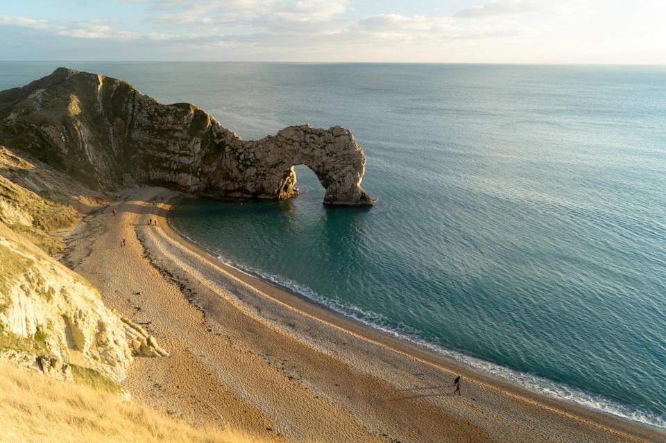 """With its dramatic limestone arch, craggy cliffs, and <a href=""""http://www.cntraveler.com/galleries/2016-01-14/where-to-find-every-color-of-sand?mbid=synd_yahoo_rss"""" rel=""""nofollow noopener"""" target=""""_blank"""" data-ylk=""""slk:soft golden sand"""" class=""""link rapid-noclick-resp"""">soft golden sand</a>, Durdle Door is one of the most scenic beaches in all of Europe. But it's not just a pretty face—the Marine Conservation Society recommends the beach for swimming and fishing, thanks to its excellent <a href=""""http://www.cntraveler.com/galleries/2016-06-21/the-worlds-clearest-waters?mbid=synd_yahoo_rss"""" rel=""""nofollow noopener"""" target=""""_blank"""" data-ylk=""""slk:water quality"""" class=""""link rapid-noclick-resp"""">water quality</a>. It's also part of the Jurassic Coast, a 95-mile stretch of coastline studded with so many spectacular geological features and fossils that UNESCO designated it a <a href=""""http://www.cntraveler.com/galleries/2016-07-19/unesco-newest-world-heritage-sites?mbid=synd_yahoo_rss"""" rel=""""nofollow noopener"""" target=""""_blank"""" data-ylk=""""slk:World Heritage Site"""" class=""""link rapid-noclick-resp"""">World Heritage Site</a> in 2001."""