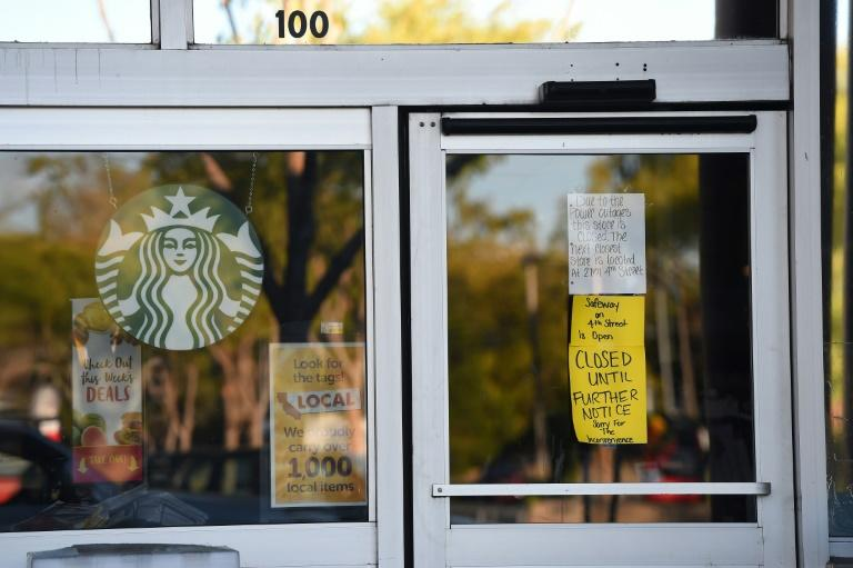 A Safeway grocery store and Starbucks Coffee are closed after the power was shut down as part of a statewide blackout in Santa Rosa, California (AFP Photo/Josh Edelson)