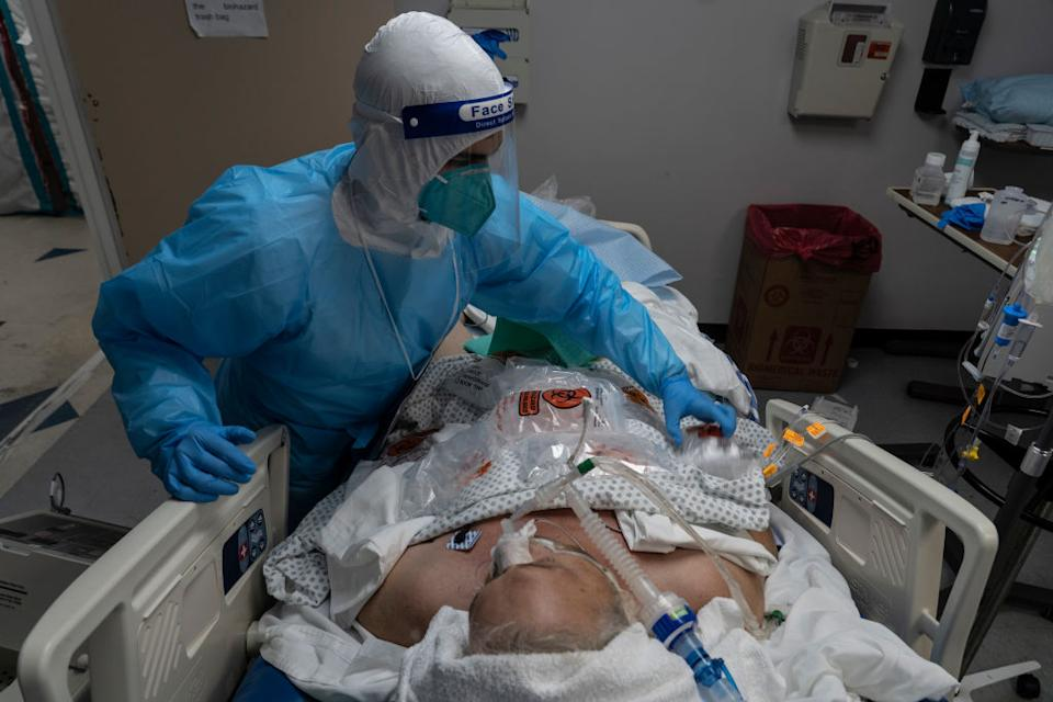 A medical staff member treats a patient suffering from the coronavirus disease (COVID-19) in the COVID-19 intensive care unit (ICU) at the United Memorial Medical Center in Houston, Texas.