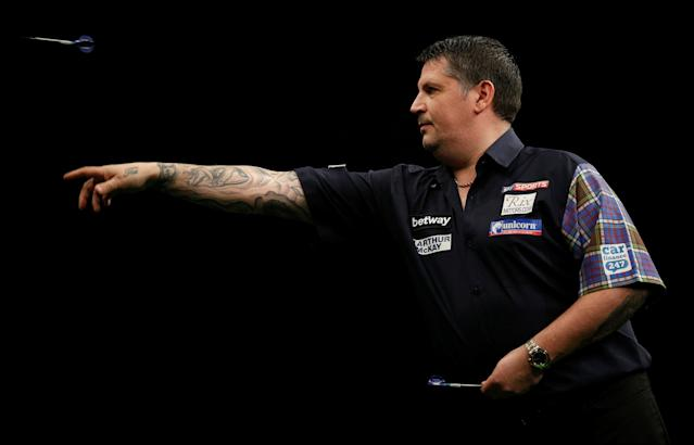 FILE PHOTO: Gary Anderson in action at the Betway Premier League Darts 2016 competition at the Motorpoint Arena in Cardiff, Britain, March 31, 2016. REUTERS/Action Images/Peter Cziborra/File Photo